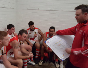 Jets League Coach; Brad McAuliffe giving instructions to his young troops